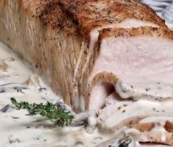 Lomo de cerdo en salsa de mostaza y hongos